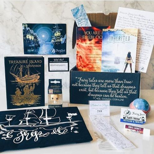 "It's time for our July unboxing! Our July PIRATES & POWER box was fully packed - it featured TWO books, one of which was an ARC that won't be released until 2017, and the other was signed and personalised by the author. It features SIX amazing goodies. Here is everything that was included: 💜 ""I Ship It"" exclusive tote by @alice.in.wonderbookland. Nikki is so talented, you should check out all of her designs! 💜 ""Currently Reading"" colouring in bookmark by my main girl @behindthe_pages. Gina is a master at creating amazing and unique products, she's also one of the most amazing people I have had the pleasure of meeting! 💜 Pirate Bounty exclusive coconut lip balm from @geekyclean. Steph and James make the absolute best geeky products! 💜 Fireblood and Frostblood exclusive tropical bath bomb by @geekyclean. It smelt soo good and the colours were amazing! 💜 Treasure Island or Articles des Voyages gold foil notebooks from Museums and Galleries. They had such gorgeous detail inside as well as outside. 💜 Jon Snow or Daenerys Targaryen @originalfunko keychain. Which keychain you got depended on which Frostblood cover was in your box. 💜 ARC of Frostblood by @elly_blake, which doesn't come out until 2017. This was such an amazing read, I'm dying for book two! Two covers went out; fire and ice, and it also came with a bookmark. 💜 Inherited by @freedommwrites, which was signed and personalised by Freedom herself! We had a blast preparing these for you guys! Inherited is a fantastic story about faery-tales, Pirates and folklore. It also came with a postcard, letter and a signed letter from the publisher which is none other than the lovely @benjaminoftomes! All in all it was an amazing box and we loved putting this together! We hope you loved this one as much as we did and we are so excited to send the August box off to you! ・ Photo by our lovely rep @infinitelynovel. Check her profile for a special discount code! ✨"